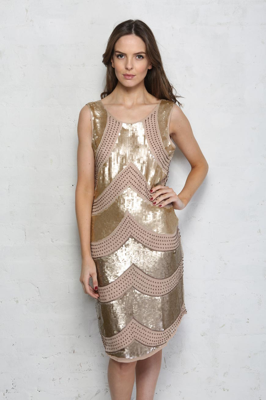 Short sequin mini-dresses are a great way to show off long, toned legs. If you prefer to avoid too much glitz, consider a dress with sequin accents that draw the attention exactly where you want it, such as at the neckline or hem.